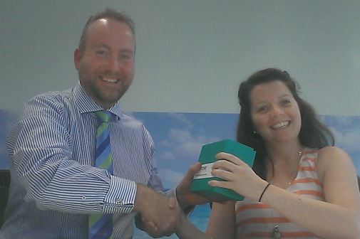 Brett Dashwood presenting Sarah Thorn from nib with the Pantone Colour of the Year mug for comments, questions, and general interactivity